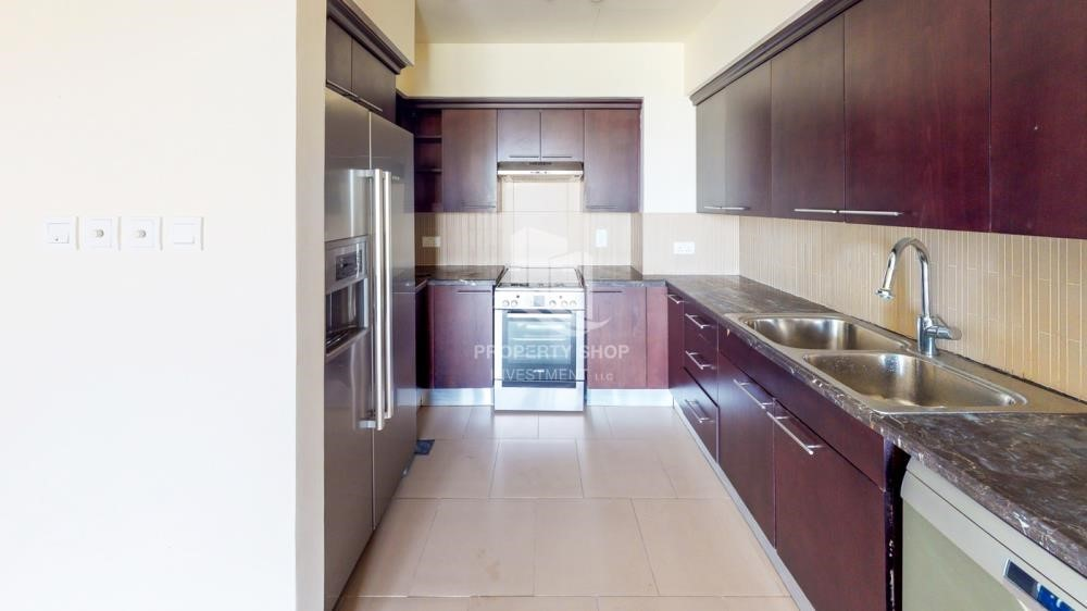 Kitchen - Beautiful and unique living spaces in Saadiyat Beach Residences, 1BR Apt Available for rent! Zero Commission!