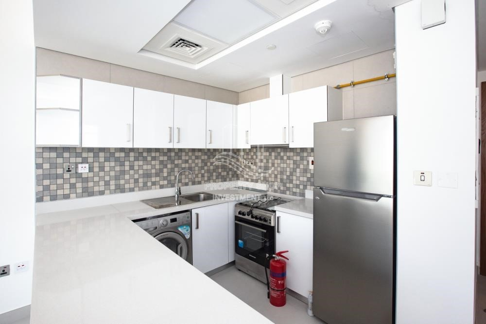 Kitchen - Spacious 2BR Apartment Available now in Parkside Residence!