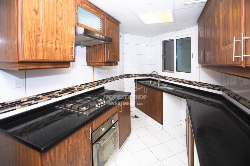 Kitchen - Spacious 2BR Apartment with Partial Sea View.