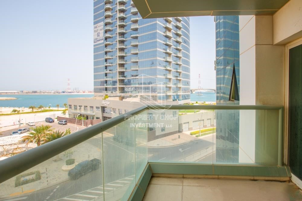 Balcony - Spacious 2BR Apartment with Partial Sea View.