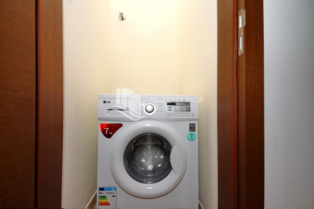 Laundry Room - Call the agent and Book for 1BR Apartment with Great Facilities!