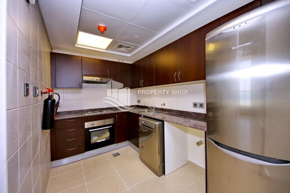 Kitchen - 2BR with built in cabinet & balcony for rent in Mangrove Place.