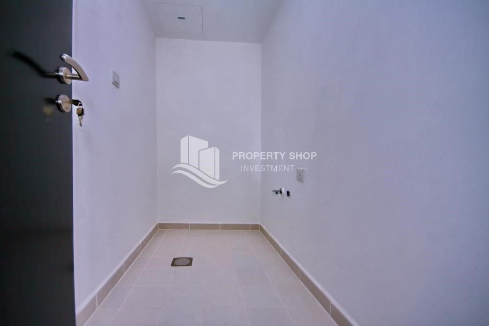 Laundry Room - 3BR+M Apt with Walk-in Closet.
