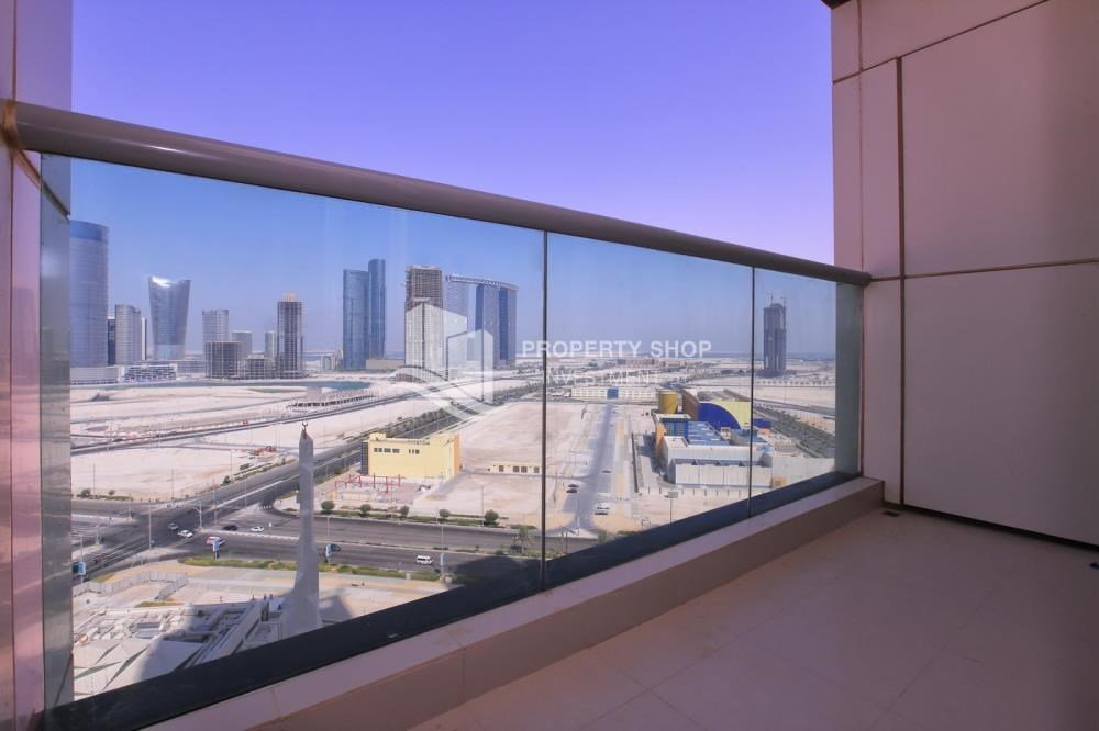 Balcony - Full sea view in a 2BR apartment with built in cabinet, balcony & free parking space in Al Maha Tower.