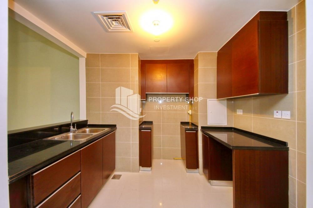 Kitchen - Full sea view in a 2BR apartment with built in cabinet, balcony & free parking space in Al Maha Tower.