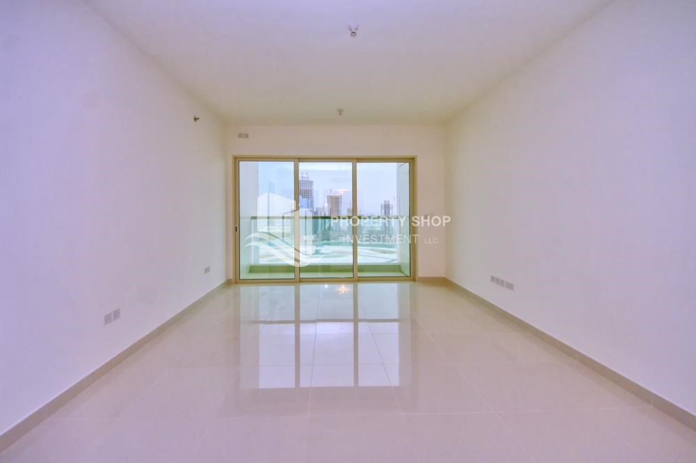 Living Room - Full sea view in a 2BR apartment with built in cabinet, balcony & free parking space in Al Maha Tower.
