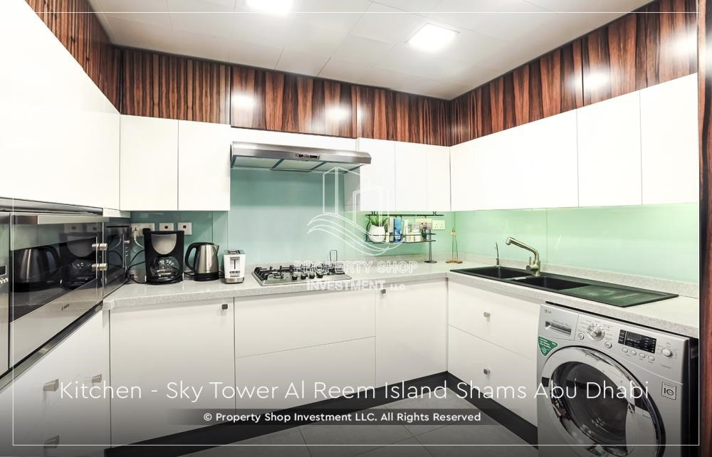 Kitchen - Own a high floor fully-furnished 2BR+M Apt with sea view plus skypod