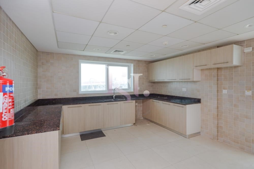 Kitchen - Stunning 3+Maid with Partial Golf Course & Ferrari World View