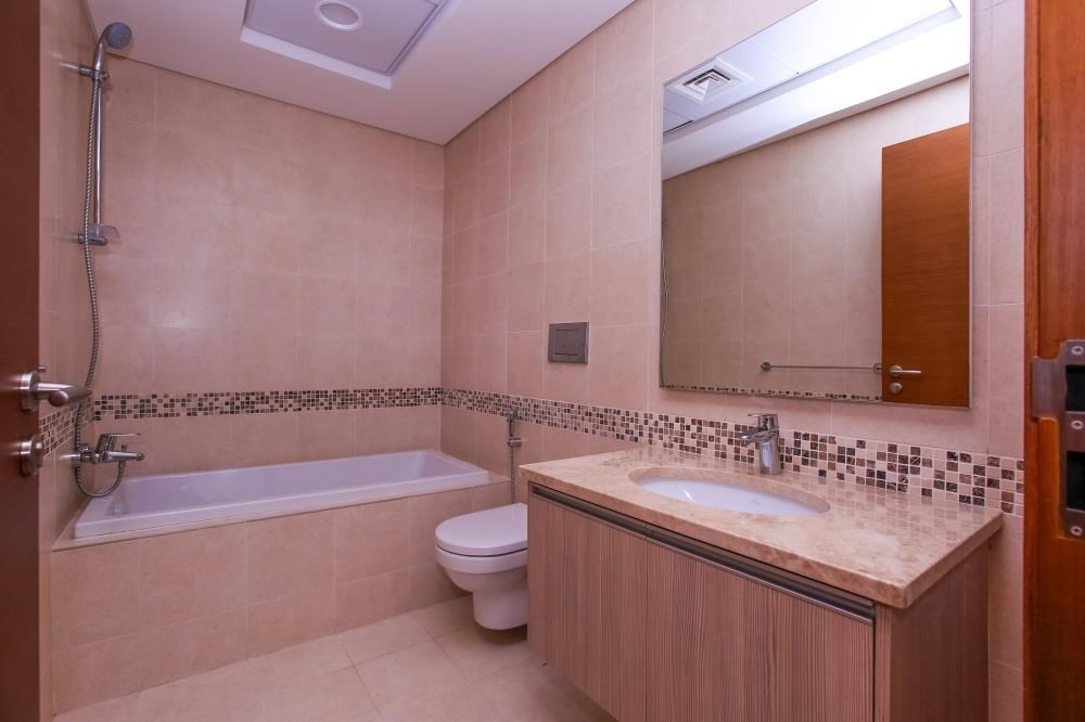 Bathroom - Experience magnificent golf views in this exquisite 3BR property in Ansam.