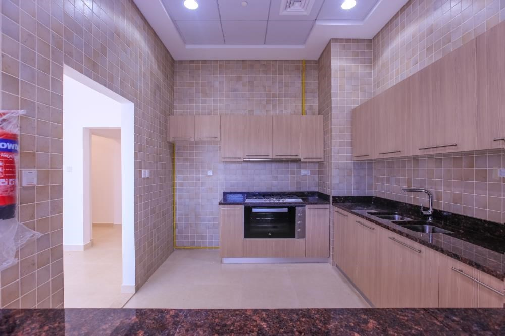 Kitchen - Experience magnificent golf views in this exquisite 3BR property in Ansam.