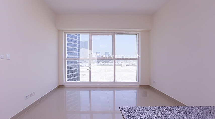 Living Room-Mid-floor 1BR unit in Marina Bay, City of Lights, for rent