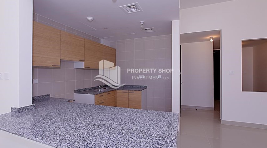 Kitchen-Mid-floor 1BR unit in Marina Bay, City of Lights, for rent