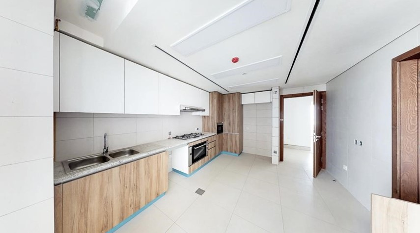 Kitchen-3br and lounge with modern and luxurious touches overlooking Al Reem Park and natural mangroves