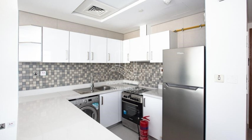 Kitchen-Spacious 2BR Apartment Available now in Parkside Residence!
