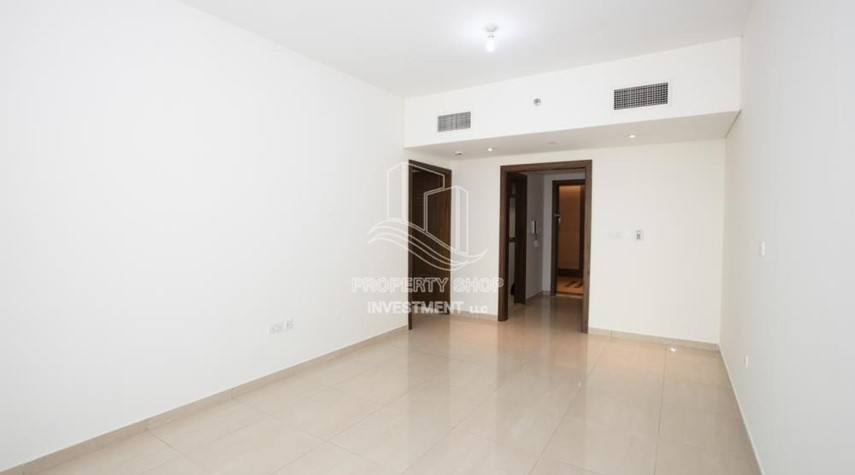Living Room-Spacious 2BR Apartment with Partial Sea View.