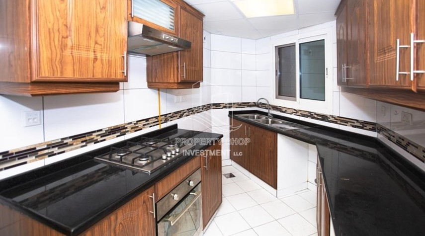Kitchen-Spacious 2BR Apartment with Partial Sea View.