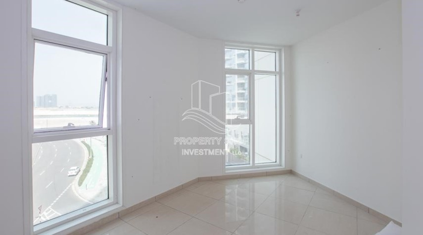 Bedroom-Spacious 2BR Apartment with Partial Sea View.
