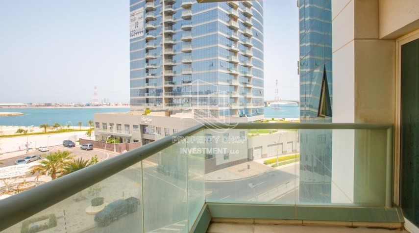 Balcony-Spacious 2BR Apartment with Partial Sea View.