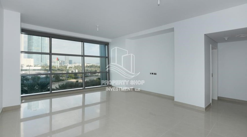 Living Room-Well Maintained 1BR Apt for rent in Etihad Towers 4.