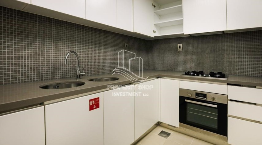 Kitchen-Well Maintained 1BR Apt for rent in Etihad Towers 4.
