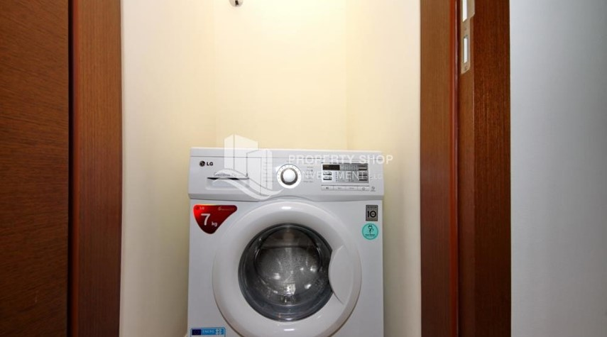 Laundry Room-Call the agent and Book for 1BR Apartment with Great Facilities!