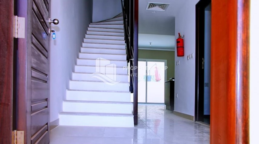 Stairs-2 BR Single Row Villa in Arabian Village for sale