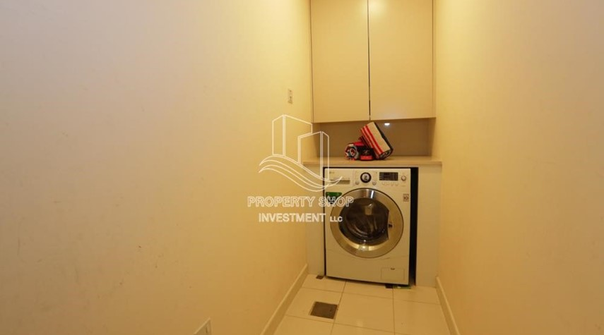 Laundry Room-Luxurious Furnished Studio with Parking in St. Regis.
