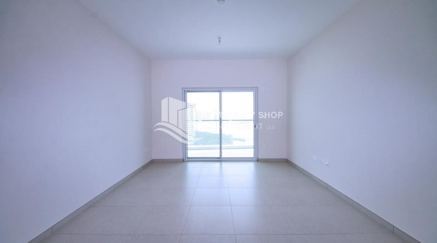 Living Room-Mid floor 1BR unit with sea view offered for 4 cheques!
