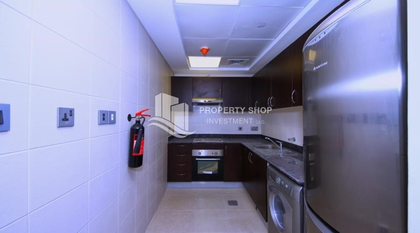 Kitchen-Relaxed ambiance in a community - garden view 1BR Apartment with balcony in Mangrove Place.