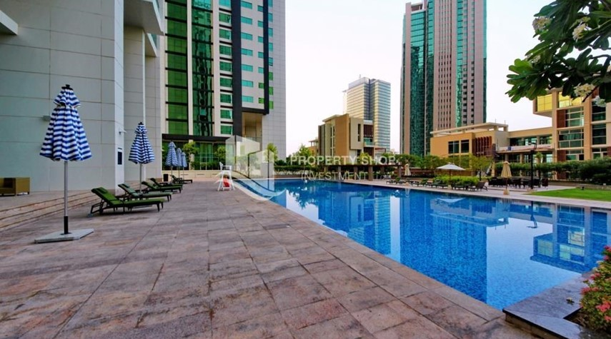 Community-Full sea view in a 2BR apartment with built in cabinet, balcony & free parking space in Al Maha Tower.