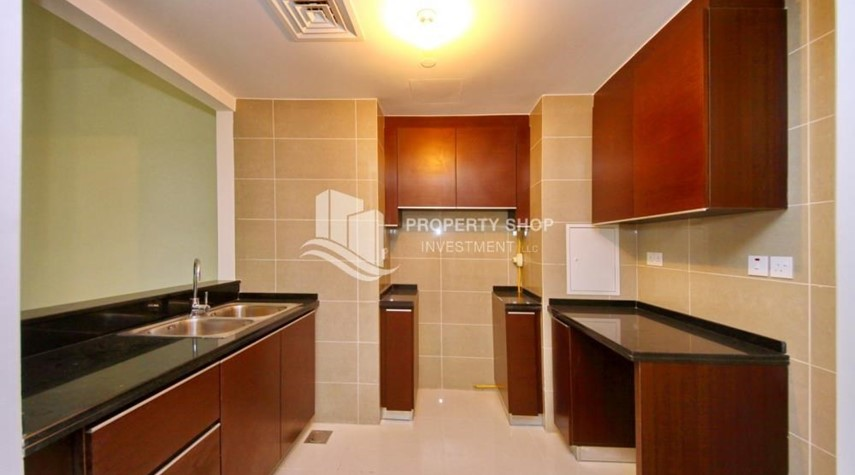 Kitchen-Full sea view in a 2BR apartment with built in cabinet, balcony & free parking space in Al Maha Tower.