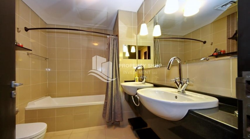 Bathroom-Stunning 1BR in High Floor with panoramic views of Al Reem community.