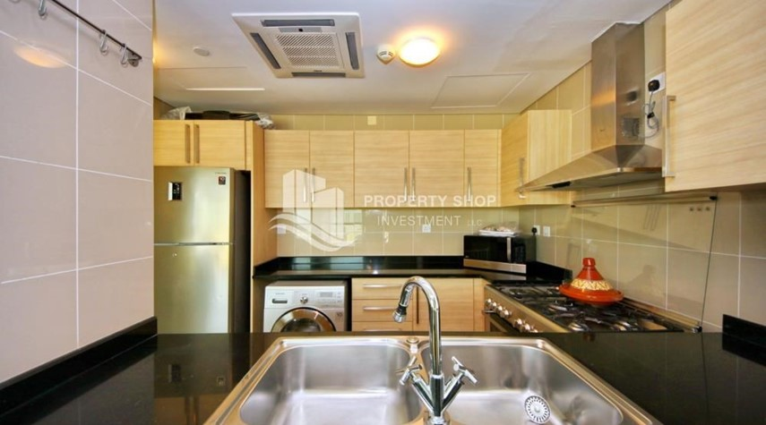 Kitchen-Stunning 1BR in High Floor with panoramic views of Al Reem community.
