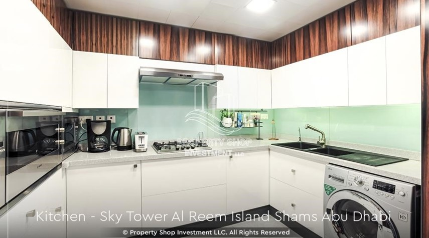 Kitchen-Own a high floor fully-furnished 2BR+M Apt with sea view plus skypod