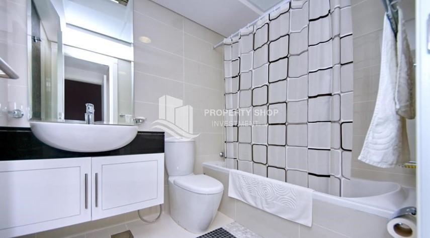 Bathroom-Spacious 1BR with balcony and sea view.