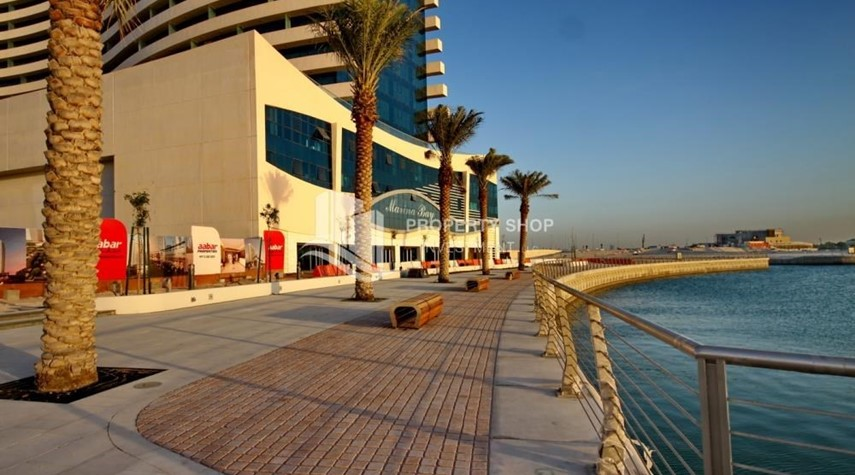 Community-Spacious 1BR with balcony and sea view.