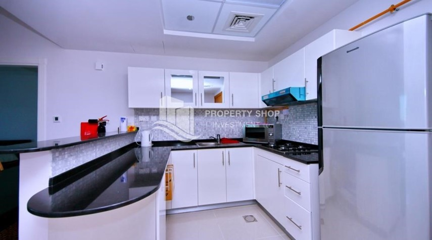 Kitchen-Spacious 1BR with balcony and sea view.