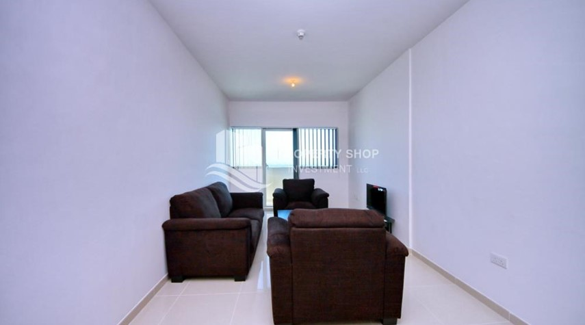 Living Room-Spacious 1BR with balcony and sea view.