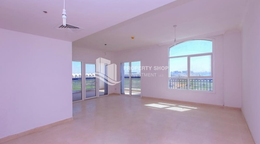 Living Room-Spacious 2 bedroom + maids with full golf and sea view