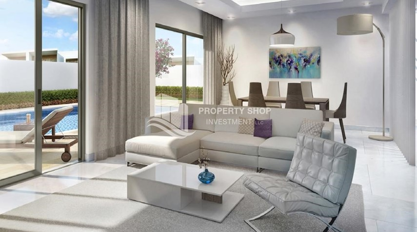 Living Room-Own a property in a luxurious community in Yas Acres.