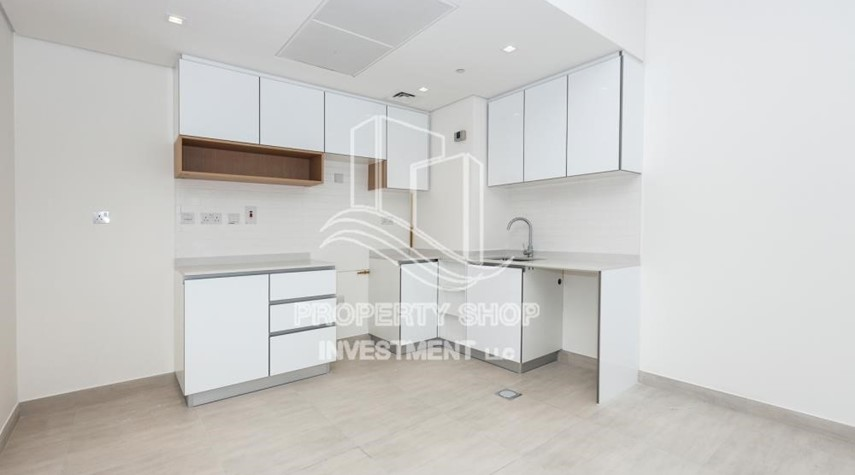 Kitchen-1BR apartment with Pool view for sale in The Bridges!