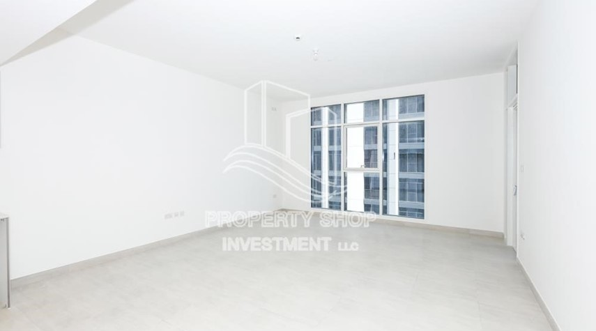Living Room-1BR apartment with Pool view for sale in The Bridges!